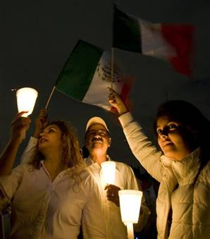 Demonstrators hold up candles Saturday at the main Zocalo square in Mexico City during a protest against the tide of killings, kidnappings and shootouts sweeping the country.