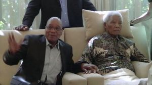 In this image taken from video, the ailing anti-apartheid icon Nelson Mandela is filmed Monday April 29, 2013, more than three weeks after being released from hospital. South African President Jacob Zuma visited the former leader on Monday, but Mandela does not appear to speak during the televised portion of the visit.